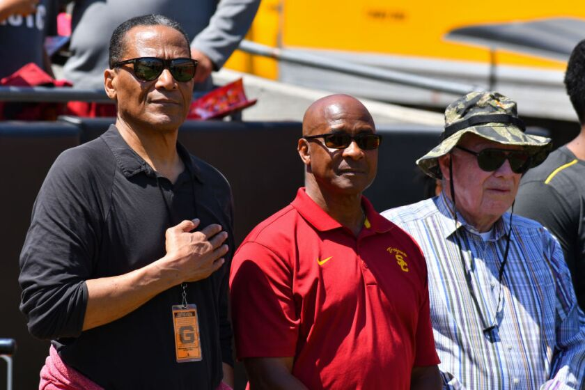 "From left, Al ""A.C."" Cowlings, Lynn Swann and B. Wayne Hughes at a spring 2017 football game."