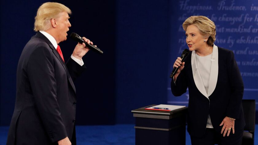 Donald Trump and Hillary Clinton engage during the second presidential debate at Washington University in St. Louis.