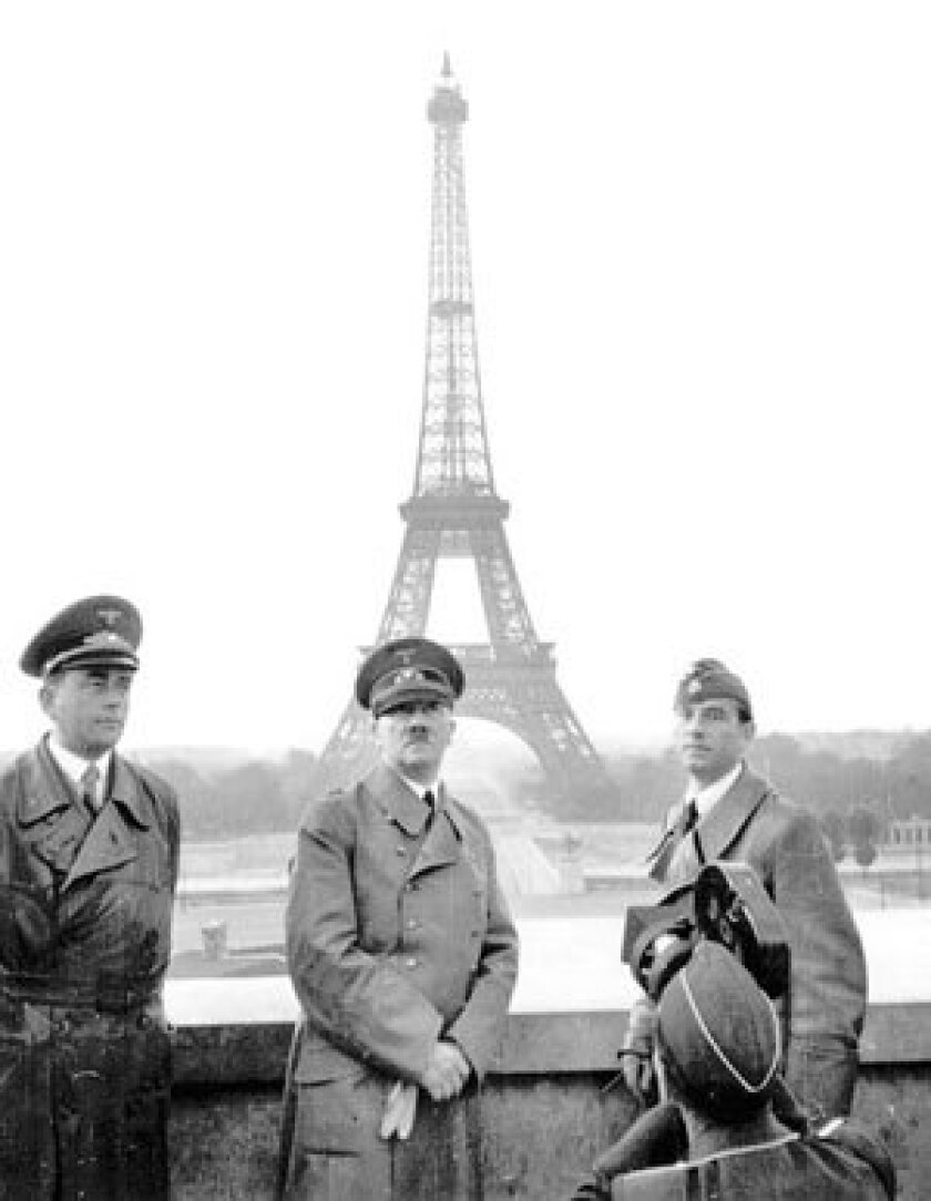 Adolf Hitler, center, poses with architect Albert Speer, left, and sculptor Arno Breker in front of the Eiffel Tower in Paris in June 1940.