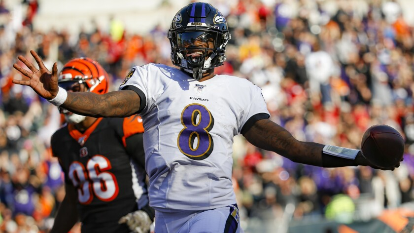 Ravens quarterback Lamar Jackson scores on a run against the Bengals during a game on Nov. 10, 2019, in Cincinnati.