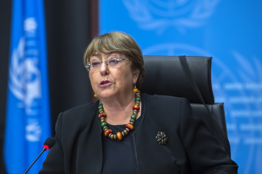 """FILE - In this Wednesday, Dec. 9, 2020 file photo Michelle Bachelet, UN High Commissioner for Human Rights, speaks during a press conference at the European headquarters of the United Nations in Geneva, Switzerland. The U.N. human rights chief is calling for a moratorium on the use of artificial intelligence technology that poses a serious risk to human rights, including face-scanning systems that track people in public spaces. Michelle Bachelet also says countries should expressly ban AI applications that don't comply with international human rights law. Applications that should be prohibited include government """"social scoring"""" systems which judge people based on their behavior and certain AI-based tools that categorize people by ethnicity or gender.(Martial Trezzini/Keystone via AP, file)"""