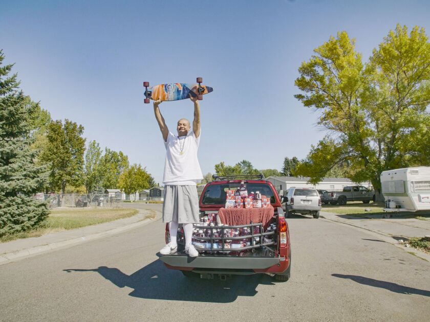 Nathan Apodaca on the back of his new truck.