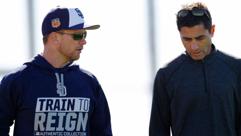 San Diego Padres manager Andy Green and General Manager A.J. Preller walk to the clubhouse after a spring training practice.