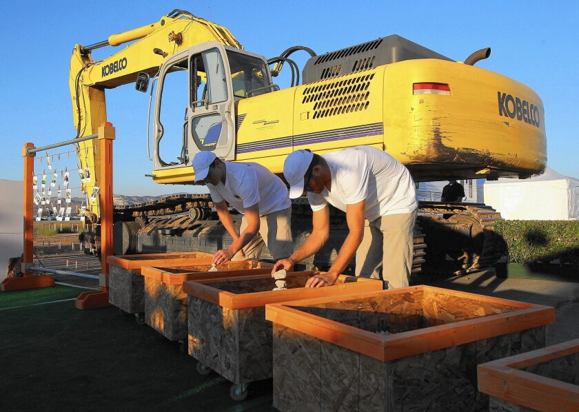 Volunteers organize pieces of the concrete of the runways that were given away as mementos during the ceremonial breaking of the concrete runways as the El Toro base was prepared to become the Great Park.