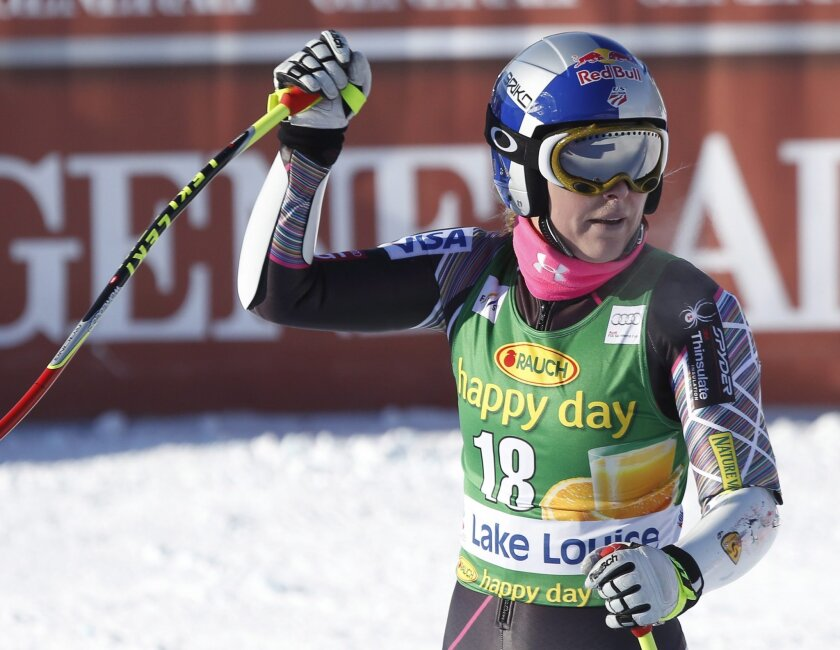 Lindsey Vonn reacts in the finish area following her run during the women's World Cup super-G skiing event at Lake Louise, Alberta, Sunday, Dec. 8, 2013. (AP Photo/The Canadian Press, Jeff McIntosh)