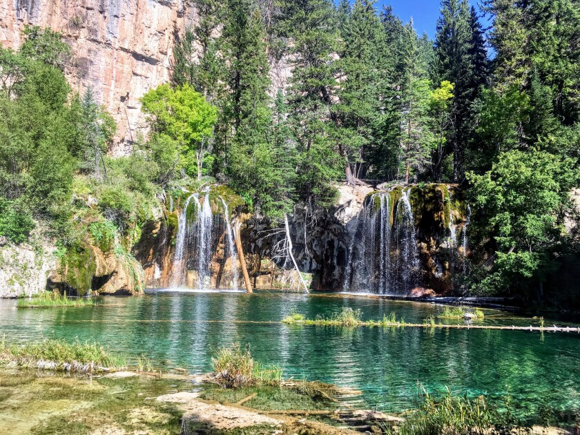 Falls spill into Hanging Lake , reached by Hanging Lake Trail in White River National Forest.