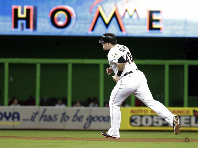 be35cc34 Miami Marlins' Justin Bour (48) runs the bases after hitting a solo home