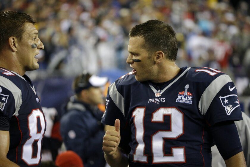 New England Patriots quarterback Tom Brady, right, talks with tight end Rob Gronkowski on the sideline in the first half of an NFL football game against the Pittsburgh Steelers, Thursday, Sept. 10, 2015, in Foxborough, Mass. (AP Photo/Stephan Savoia)
