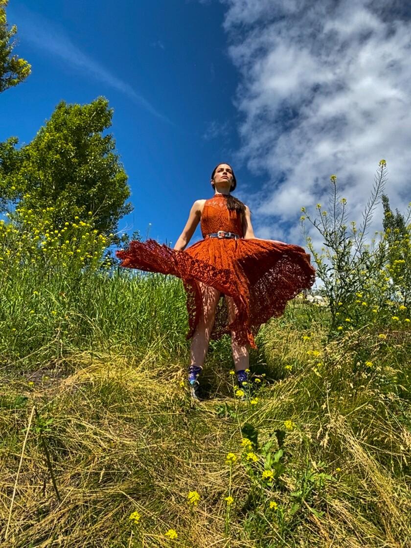 Melanie Scrofano on a hillside