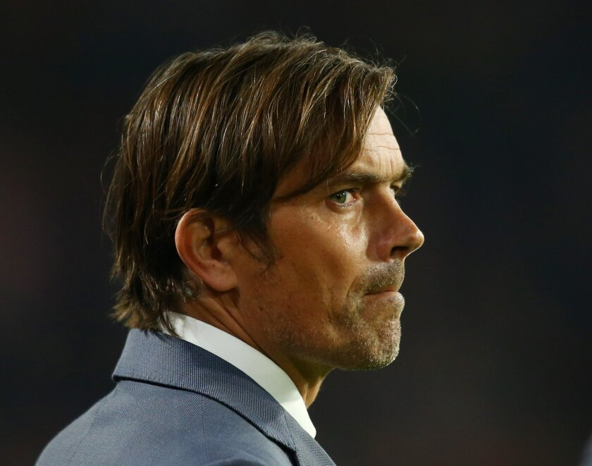 Eindhoven's coach Philip Cocu looks on prior to the Champions League Group B soccer match between PSV and VfL Wolfsburg at Philips stadium in Eindhoven, Netherlands, Tuesday, Nov. 3, 2015. (AP Photo/Peter Dejong)