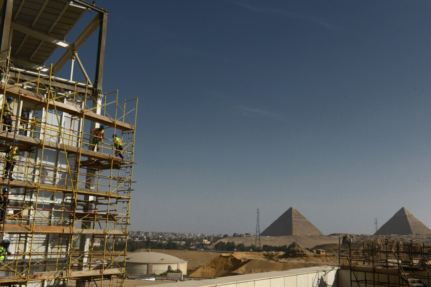 Construction work undergoing at the site of the Grand Egyptian Museum with the Great Pyramids of Giz