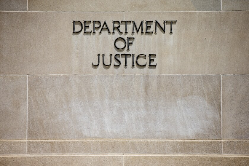 FILE - In this June 19, 2015, file the Justice Department Building in Washington. The Justice Department says pharmaceutical company Sandoz Inc. will pay a $195 million penalty to resolve criminal charges of conspiring to fix prices and rig bids for generic drugs. Officials say Monday, March 2, 2020, that the company would admit guilt and pay the penalty. (AP Photo/Andrew Harnik, File)