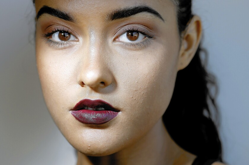 The new fall lip color is dark purple. Lipsticks that fit the bill include Nars' Liv, as seen on model Ashleigh Rae.