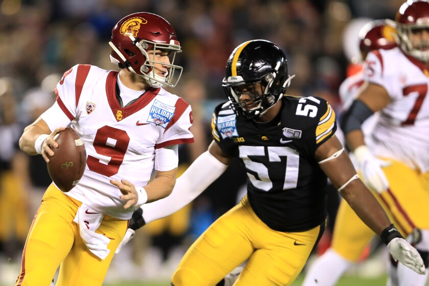 Iowa's Chauncey Golston tries to chase down USC quarterback Kedon Slovis in the Holiday Bowl on Dec. 27, 2019.