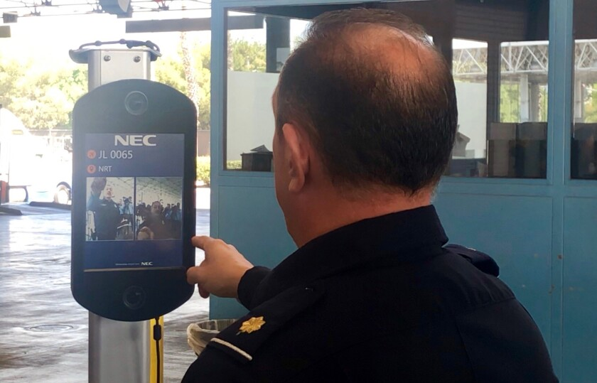 Customs officer demonstrates use of facial recognition cameras at ports of entry