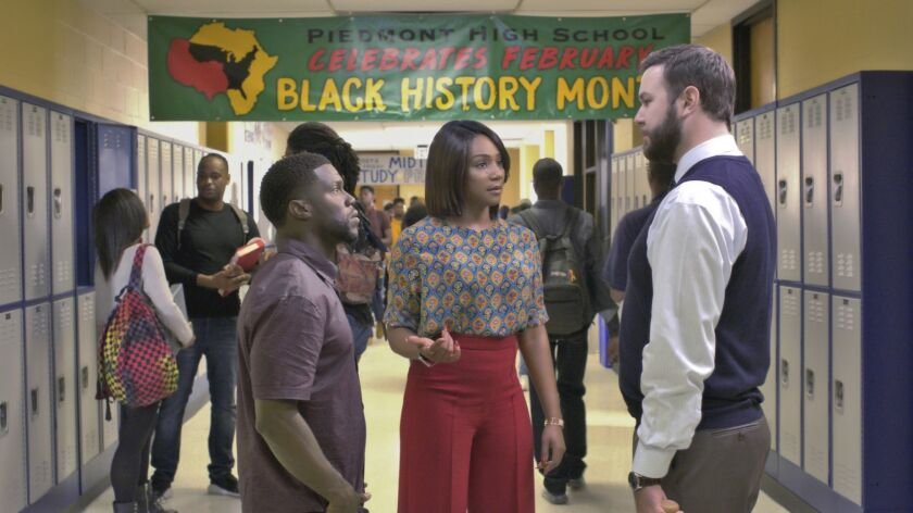 """This image released by Universal Pictures shows Kevin Hart, left, Tiffany Haddish and Taran Killam in a scene from """"Night School."""" (Universal Pictures via AP)"""