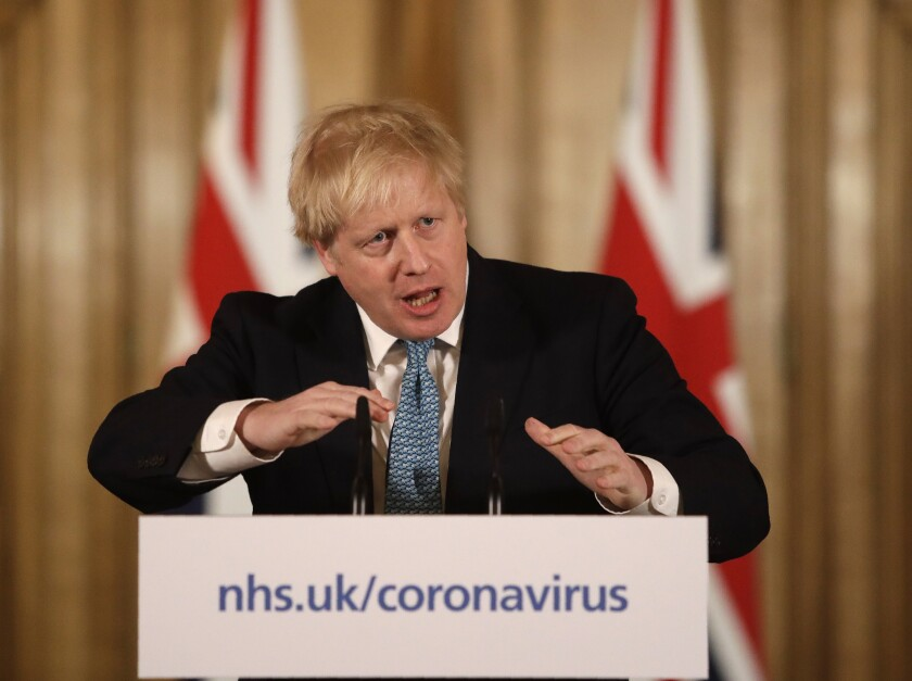 British Prime Minister Boris Johnson speaks at a press conference