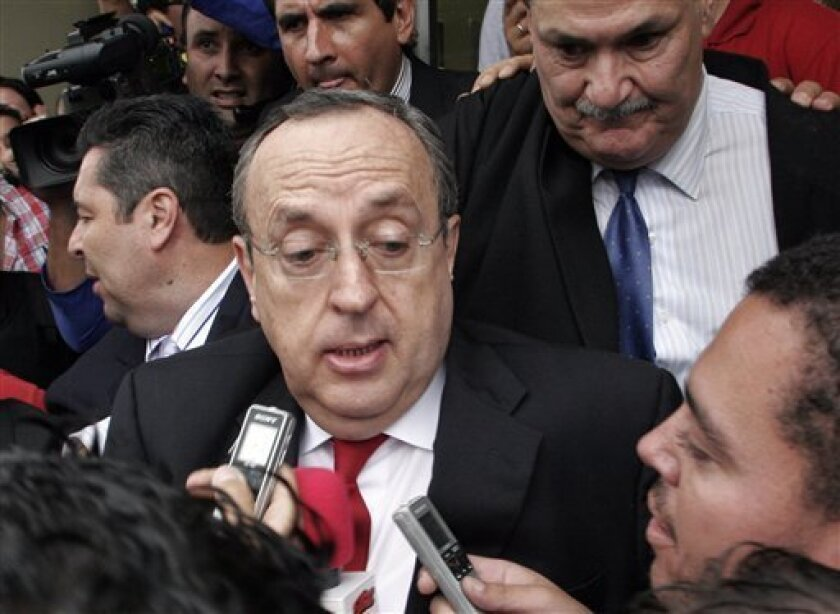 Former Costa Rica's President Rafael Angel Calderon, center, who was president from 1990 to 1994, speaks to reporters at the end of his trial in San Jose, Monday, Oct. 5, 2009. A Costa Rican court found Calderon guilty of embezzlement and sentenced him to five years in prison. (AP Photo/Kent Gilbert)