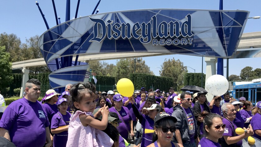 Disneyland workers from several unions protest at the entrance to Disneyland in Anaheim on July 3, 2018.