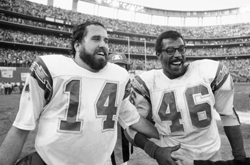 FILE - In this Jan. 5, 1980, file photo, San Diego Charges quarterback Dan Fouts (14) and running back Chuck Muncie (46) flash big smiles as they leave field following the Chargers 20-14 over the Buffalo Bills in an NFL football playoff game in San Diego. The New Orleans Saints announced Tuesday, M
