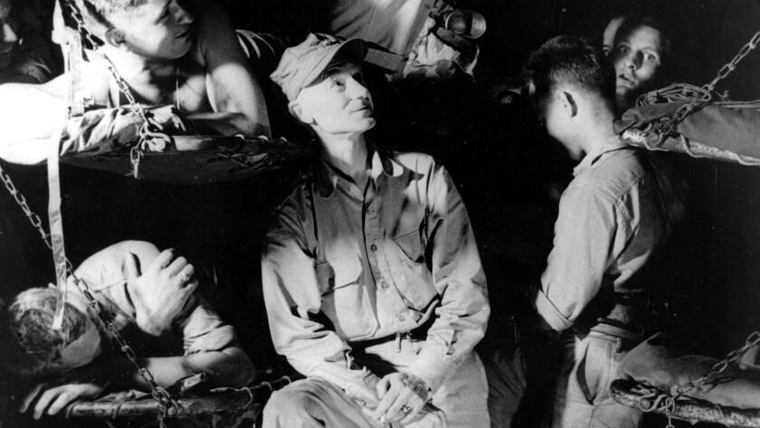 U.S. war correspondent Ernie Pyle talks with Marines during World War II.