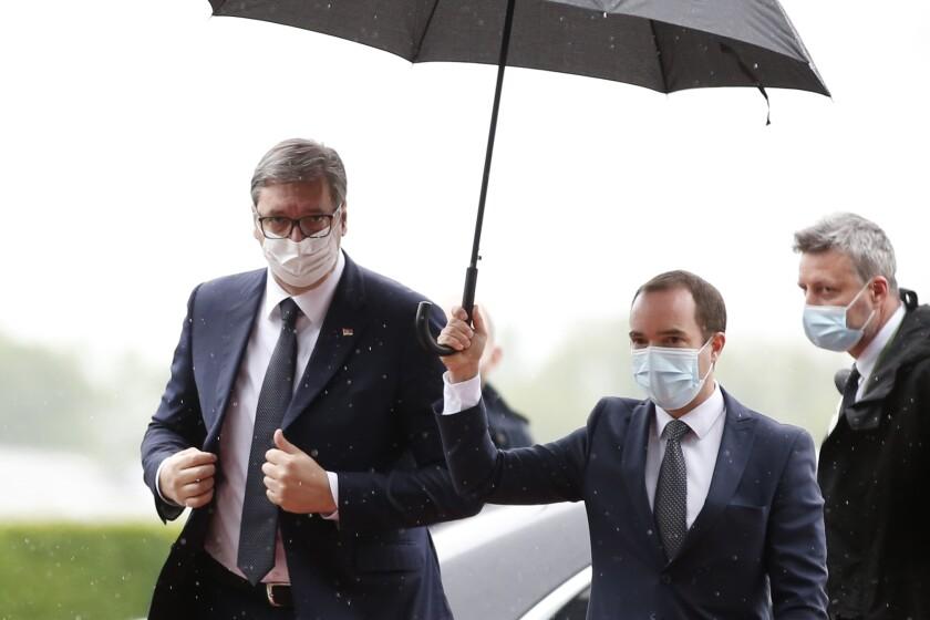 Serbia's President Aleksandar Vucic arrives at the Brdo-Brijuni summit, in Brdo, Slovenia, Monday, May 17, 2021. The Brdo-Brijuni Process summit had originally been planned for last year, to coincide with the 10th anniversary of the initiative, but had been postponed twice due to the coronavirus pandemic. (AP Photo/Darko Bandic)