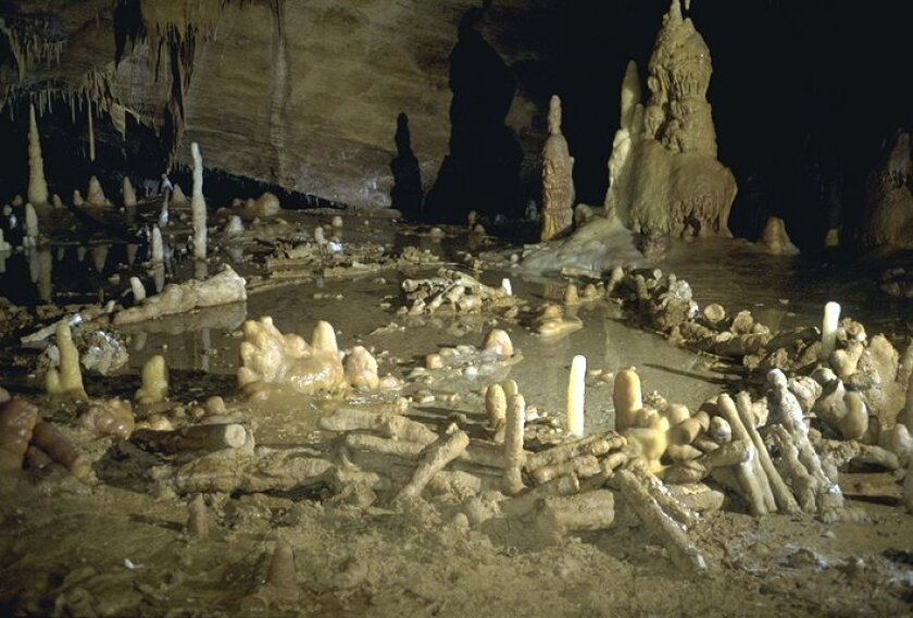 This is an undated image released by CNRS on Wednesday May 25, 2016 of stone rings inside a cave on Bruniquel in France. Scientists say that a pair of mysterious stone rings found deep inside a French cave was probably built by Neanderthals about 176,500 years ago, proving that our ancient cousins