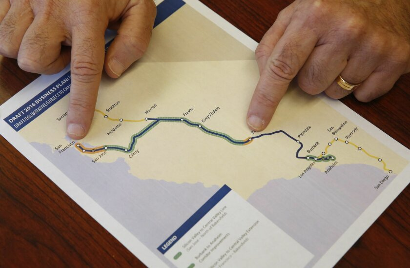 Dan Richard, chairman of the board that oversees the California High-Speed Rail Authority, gestures to a map showing the proposed initial construction of the bullet train in the revised business plan, Thursday, Feb. 18, 2016, in Sacramento, Calif. Officials of the high-speed rail system say they wi