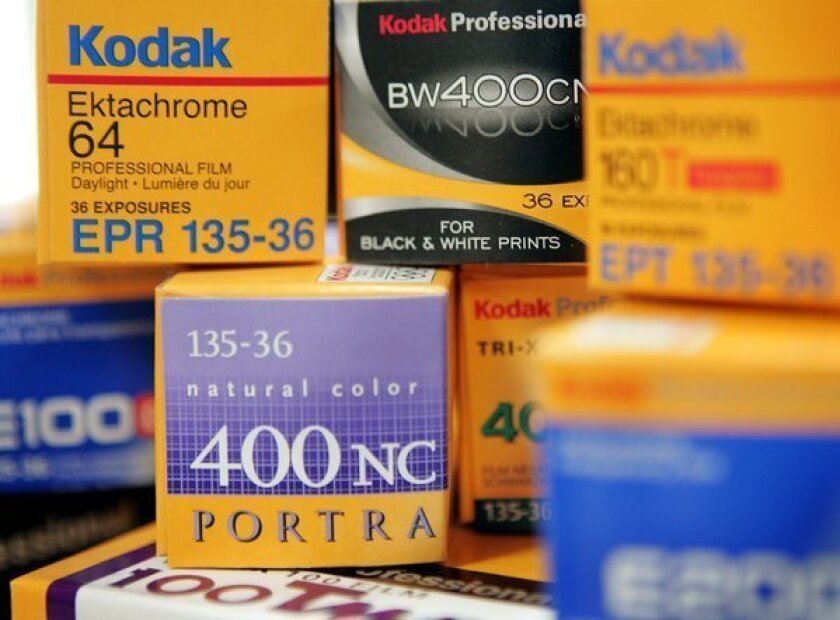 Kodak said Friday that it would cut more jobs than expected and phase out its consumer inkjet printer business.