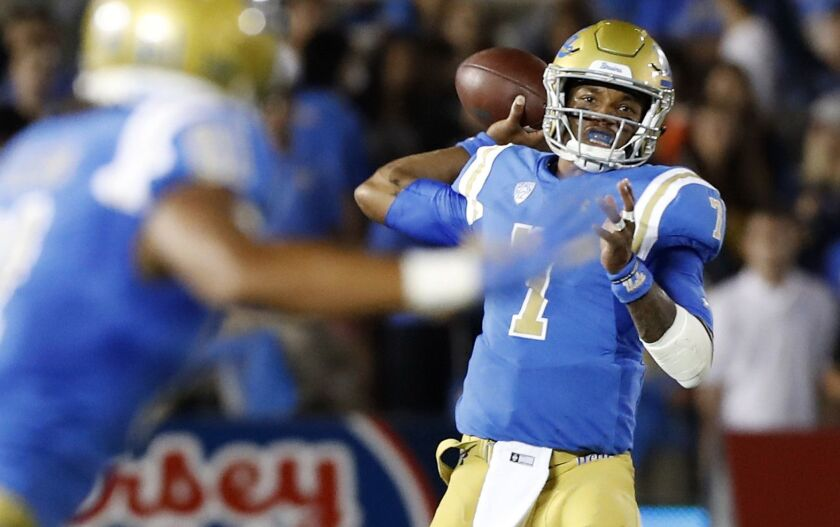 PASADENA, CALIF. - SEP. 28, 2018. UCLA quarterback Dorian Thompson-Robinson connects with tight end