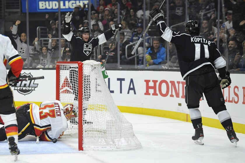 Kings right wing Tyler Toffoli celebrates with center Anze Kopitar after scoring a goal against the Flames during the second period of a game Feb. 12 at Staples Center.