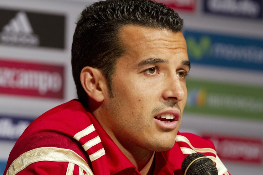 Spain World Cup soccer team member Pedro Rodriguez speaks to the media before their Saturday friendly match against El Salvador in Washington, Thursday, June 5, 2014. (AP Photo/Jacquelyn Martin)