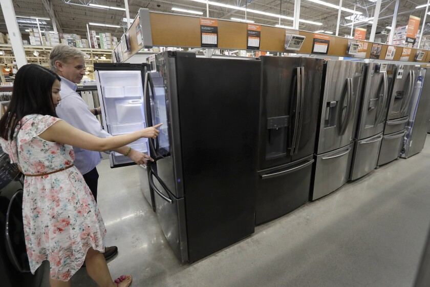 Shoppers examine refrigerators at a Home Depot store in Boston on Sept. 23.