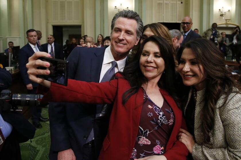 Gov. Gavin Newsom with Assemblywoman Blanca Rubio and Sen. Susan Rubio