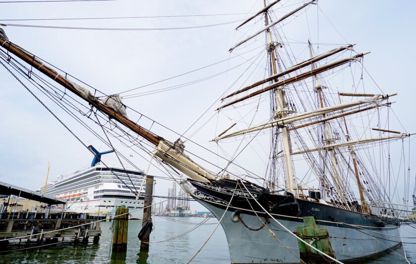 The tall ship Elissa greets the Carnival Freedom in Galveston.