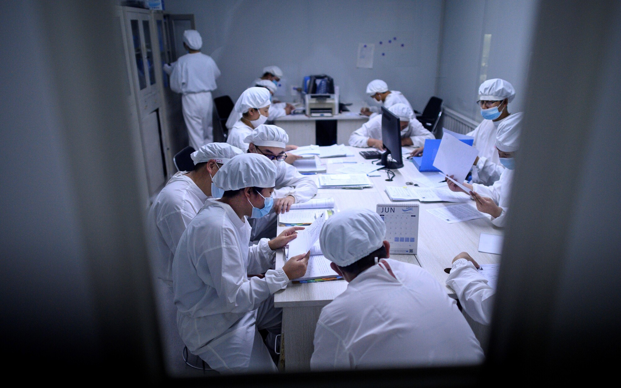 Researchers work in a lab at Yisheng Biopharma, one of a number of companies in China trying to develop a COVID-19 vaccine.