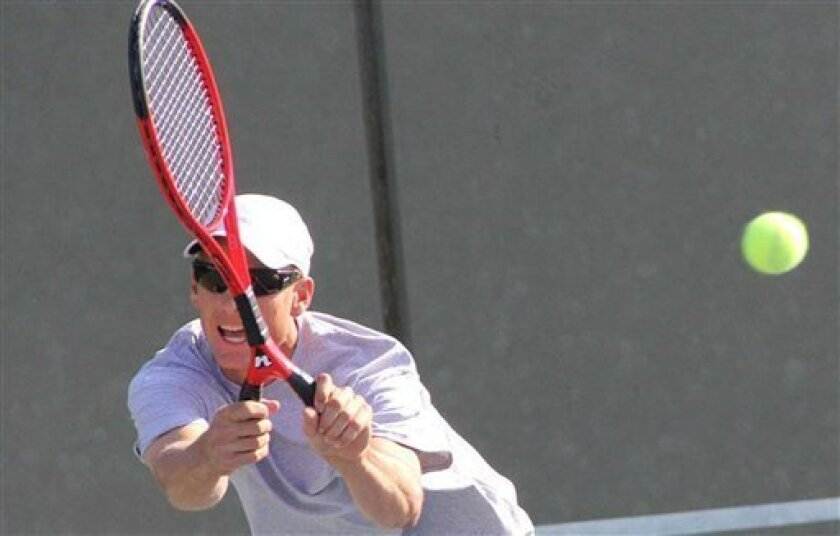 This photo released by the USTA shows Brian Battistone using a two-handled tennis racket during the US Open National Playoffs held earlier this summer. (AP Photo/USTA)