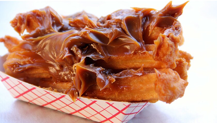 """South County residents swear by Churros El Tigre, a food stand at the Las Americas outlets mall on the border in San Ysidro. Be sure to order the fried-to-order treats with extra-thick caramel """"cajeta"""" sauce."""""""