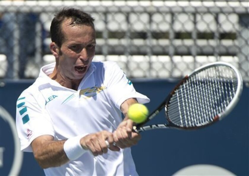 Radek Stepanek from the Czech Republic returns to Nicolas Almagro from Spain during first round of play at the Rogers Cup tennis tournament Tuesday Aug. 6, 2013 in Montreal. (AP Photo/The Canadian Press, Paul Chiasson)