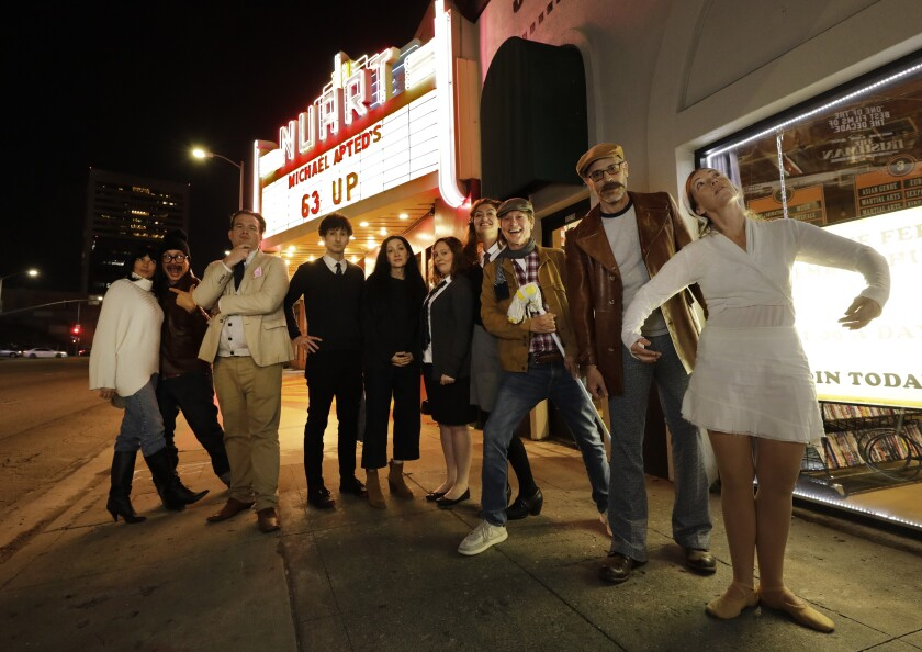 """Left to right, dressed as figures from Michael Apted's documentary film series """"Up"""": Jessica Benton, Timbo, C. Brian Smith, Gabe Diani, Annabelle Gurwitch, Etta Devine, Maggie Rowe, Jim Vallely, Jack Rudy and Susie McDonnell."""