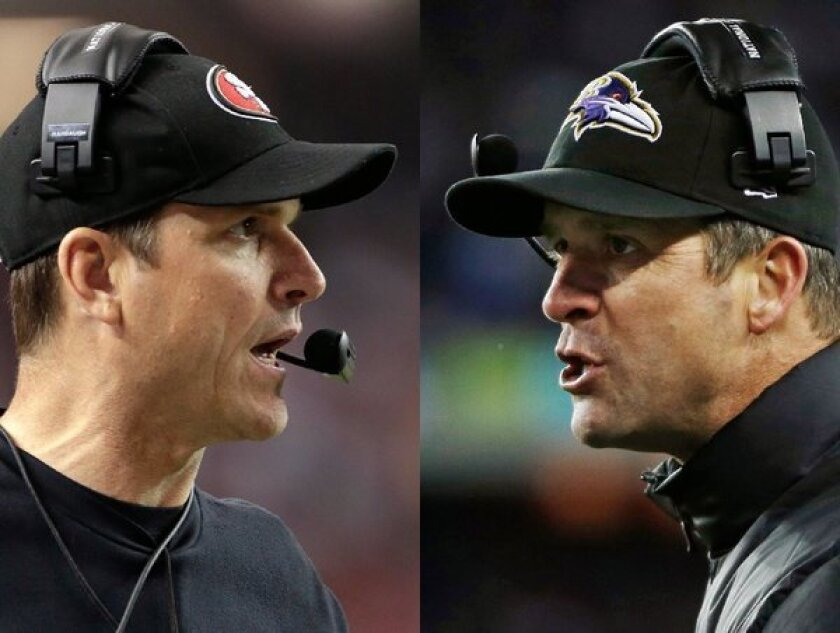Coaching brothers Jim Harbaugh, left, of the 49ers and John Harbaugh of the Ravens.