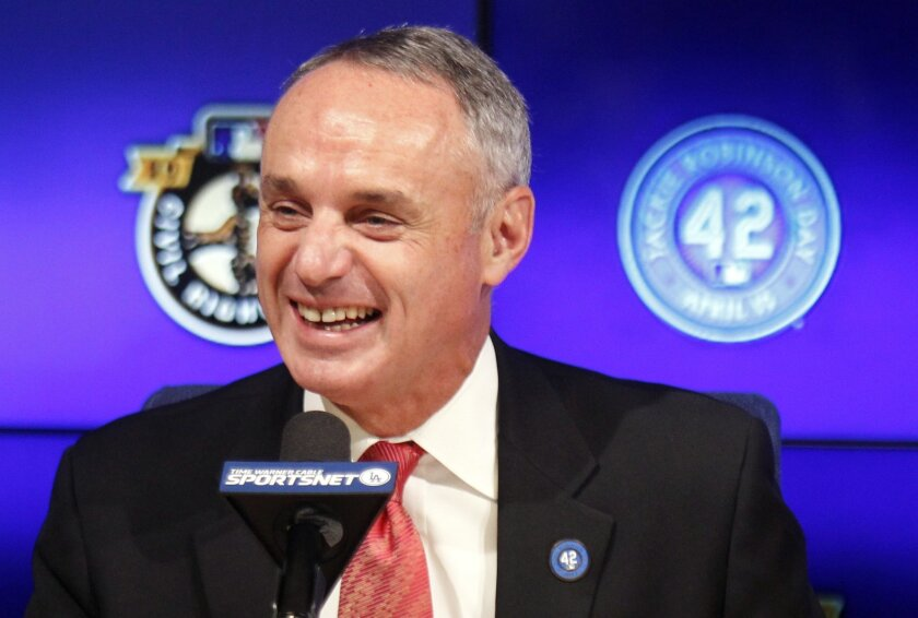 FILE - In this April 15, 2015, file photo, Major League Baseball Commissioner Rob Manfred talks during a news conference prior to a baseball game between the Los Angeles Dodgers and the Seattle Mariners on Jackie Robinson Day in Los Angeles. Manfred said Thursday, April 23, 2015, that Pete Rose will play some role during this summer's All-Star Game in Cincinnati. (AP Photo/Alex Gallardo, File)