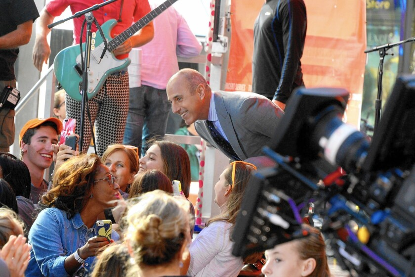 """Matt Lauer greets fans at NBC's """"Today"""" show. """"Today"""" is one of the most profitable shows on television."""