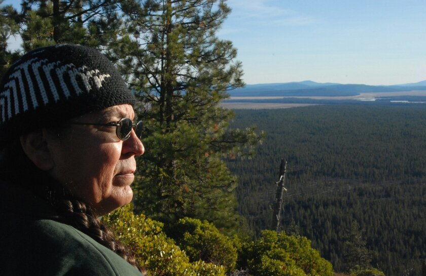 FILE - This Dec. 8, 2008 file photo shows Jeff Mitchell of the Klamath Tribes standing on Round Butte north of Chilquin, Ore., looking over a piece of the tribes' former reservation that they hope to buy back. Tribal Chairman Don Gentry said Friday, Feb. 20, 2015 that the unexpected sale of the Maz