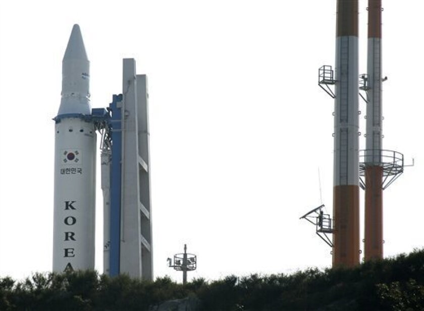 The Korea Space Launch Vehicle-1, South Korea's second space rocket, sits on its launch pad at the Naro Space Center in Goheung, South Korea, Wednesday, June 9, 2010. South Korea's space program suffered a fresh setback Wednesday when the planned launch of a satellite was postponed due to malfunctioning firefighting equipment. (AP Photo/Korea Pool)