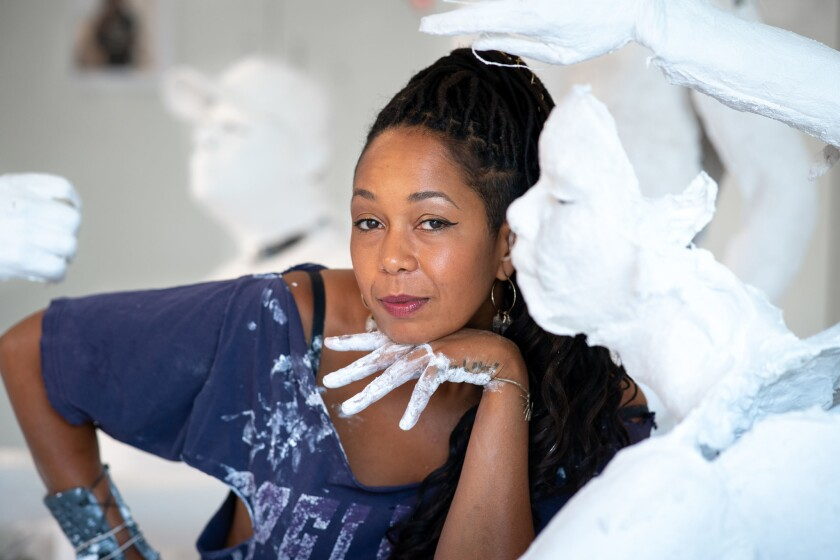 """Karon Davis is shown in her Ojai studio as she prepares for her second solo exhibition at Wilding Cran Gallery, """"Muddy Water."""" The exhibition addresses climate change, natural disasters and evacuation and displacement."""