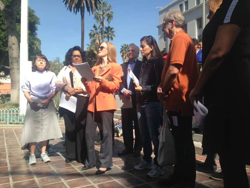 Members of the Coalition to Preserve L.A., appearing outside City Hall, said Tuesday they had changed their strategy for winning passage of their planned Neighborhood Integrity Initiative -- rewriting the measure and shifting their focus to the March 2017 election.