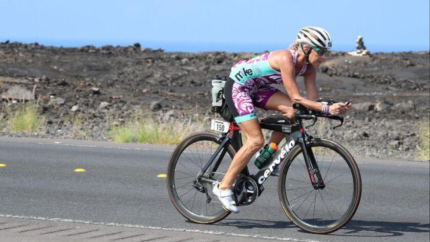 Kathleen McCartney embarks on the bike portion of the 2017 Ironman World Championship on Oct. 14 in Kona, Hawaii.