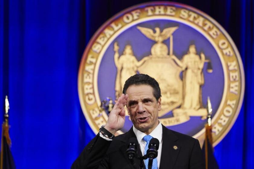 New York State Governor Andrew Cuomo delivers a speech after taking the oath of office administered by Chief Judge of the New York Court of Appeals Janet DiFiore during an inauguration ceremony on Ellis Island in New York, New York. EFE/EPA/James Keviom/File