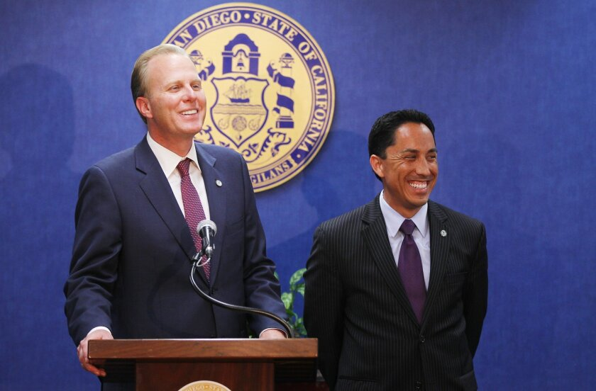 Mayor Kevin Faulconer, left, and City Council President Todd Gloria both ran for city office under pay levels that were set in 2003.